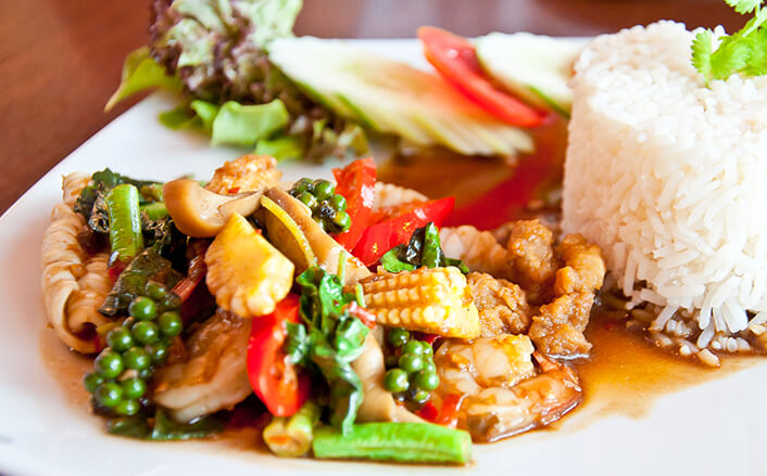 Photo of Thai food on white plate