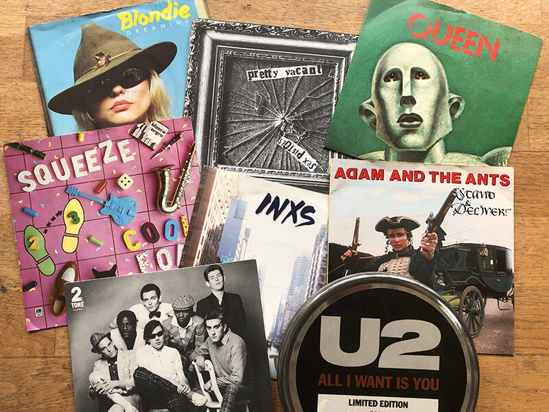 Photograph of various vinyl single records