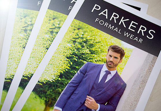 Photograph of tri folded A4 leaflets for Parkers Formal Wear, Lowestoft