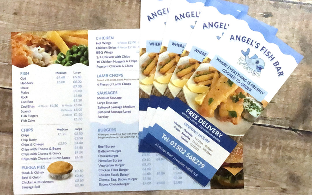 Photograph of Angels Fish Bar Take Away menus on a rustic wooden plank background